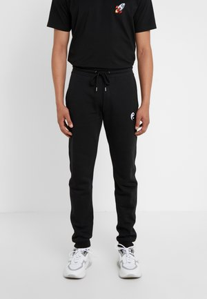 PANTS MAN SMALL YIN YANG - Tracksuit bottoms - black