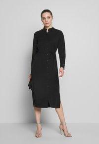 Calvin Klein - BELTED MIDI DRESS - Shirt dress - black - 0
