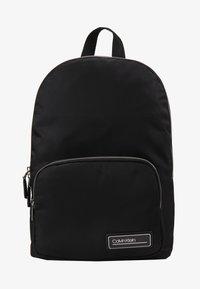 Calvin Klein - PRIMARY ROUND BACKPACK - Rucksack - black - 1