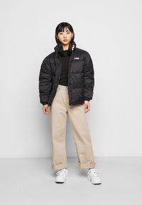 Fila Petite - SUSSI PUFF JACKET - Winter jacket - black - 1