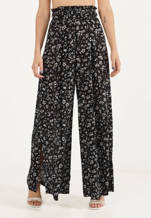 BLUMENPRINT - Trousers - black