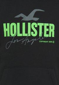 Hollister Co. - GLOW IN THE DARK  - Sweatshirt - black with green - 2