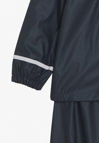Name it - NKNDRY RAIN SET - Kalhoty do deště - dark sapphire - 5
