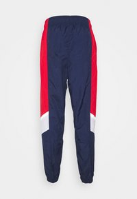 Nike Sportswear - Tracksuit bottoms - midnight navy/university red/white - 1