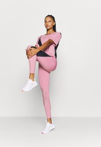 Puma - TRAIN PEARL FULL - Tights - foxglove - 1