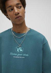 PULL&BEAR - Print T-shirt - mottled dark green - 3