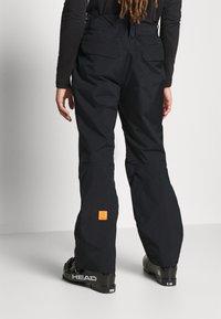 Helly Hansen - SOGN - Spodnie narciarskie - black - 3