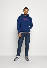 Levi's® - PEANUTS RELAXD GRAPHIC HOODIE - Jersey con capucha - blues - 1