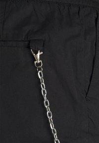 Redefined Rebel - HARVEY PANTS - Cargo trousers - black - 5
