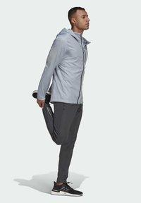 adidas Performance - OWN THE RUN WIND RESPONSE RUNNING JACKET - Windbreaker - grey - 1