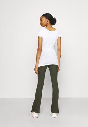 PANTS - Trousers - grape leaf