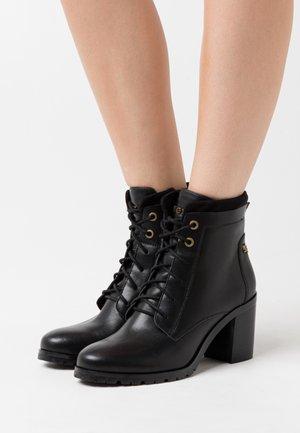 FELIPA - Šněrovací kotníkové boty - black