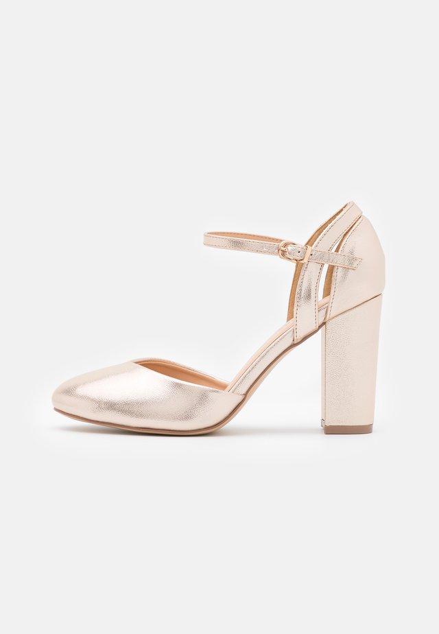CASTLE - Classic heels - gold shimmer