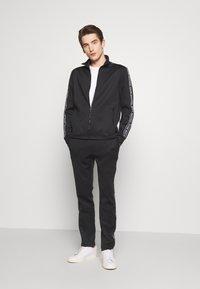Michael Kors - STREET LOGO PANTS - Teplákové kalhoty - black - 1