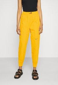 Nike Sportswear - PANT  - Pantalon de survêtement - university gold - 0