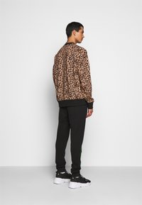 Versace Jeans Couture - FELPA - Teplákové kalhoty - black - 2