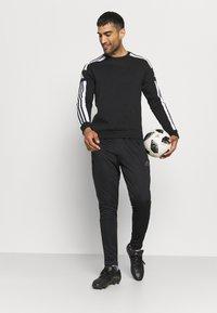 adidas Performance - TIRO  - Pantalon de survêtement - black - 1