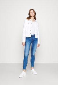 Tommy Jeans - VIVIANNE SLIM TRUCKER  - Denim jacket - white - 1
