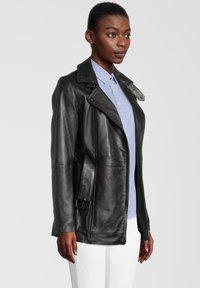 7eleven - Leather jacket - black - 2