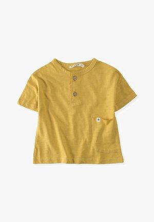 POCKET - T-shirt print - mustard yellow