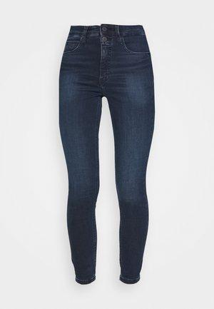 HIGH RISE SUPER SKINNY ANKLE - Jeans Skinny Fit - denim dark