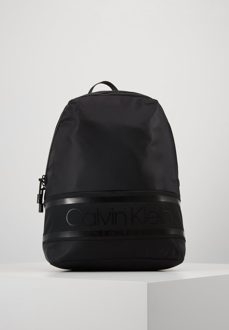 Calvin Klein - STRIPED LOGO ROUND BACKPACK - Rucksack - black