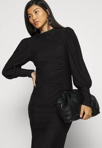 Gestuz - RIFAGZ PUFF DRESS - Day dress - black - 5