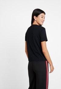 Calvin Klein Jeans - MULTI LOGO BOX STRAIGHT TEE - Print T-shirt - black - 2