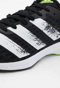 adidas Performance - ADIZERO BOUNCE SPORTS RUNNING SHOES - Competition running shoes - core black/footwear white/signal green - 5