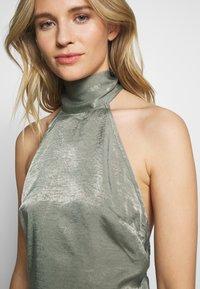 UNIQUE 21 - HALTERNECK OPEN BACK DRESS - Společenské šaty - green - 5