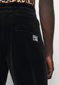 Versace Jeans Couture - MAN TROUSER - Tracksuit bottoms - nero - 6