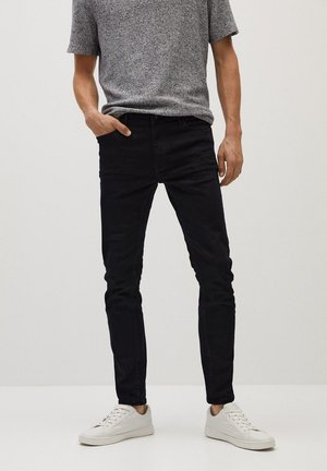 JUDE - Slim fit jeans - black denim