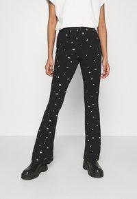 Colourful Rebel - STAR EYE PRINT BASIC FLARE PANTS - Trousers - black - 3