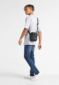 Eastpak - THE ONE/CONSTRUCTED - Across body bag - constructed black - 1