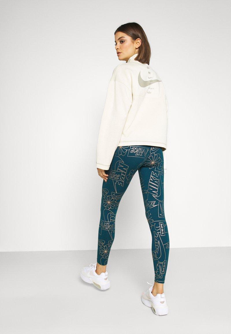 Nike Sportswear - TIGHT - Leggings - Trousers - valerian blue