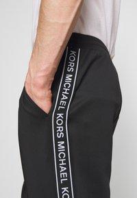 Michael Kors - STREET LOGO PANTS - Teplákové kalhoty - black - 5
