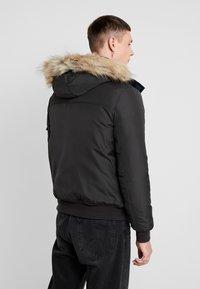 Tommy Jeans - TECH JACKET - Veste d'hiver - black - 5
