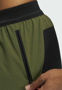 adidas Performance - STUDIO TECH SHORTS - Sports shorts - green - 5