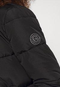 Calvin Klein - LOGO PUFFER JACKET - Winter jacket - black - 6