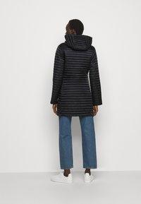 Save the duck - IRIS ALBERTA LONG HOODED COAT - Winter coat - black - 2