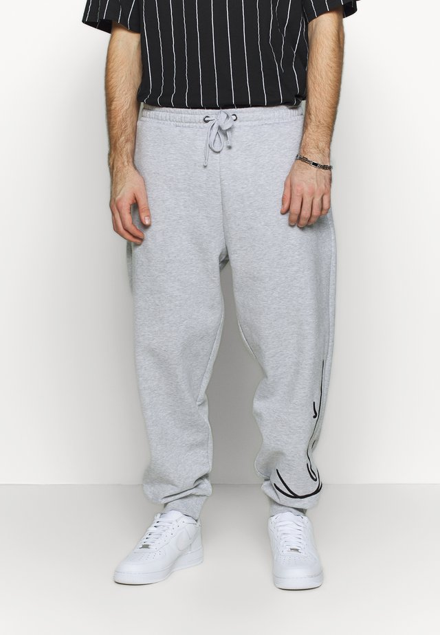 SIGNATURE RETRO - Tracksuit bottoms - grey/black