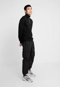 YOURTURN - Cargo trousers - black - 1