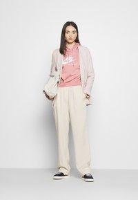 Nike Sportswear - HOODIE - Hoodie - rust pink/white - 1