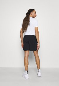 Under Armour - Sports shorts - black - 2