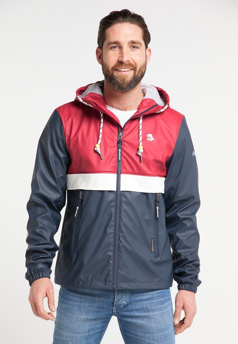 Schmuddelwedda - Waterproof jacket - red/marine