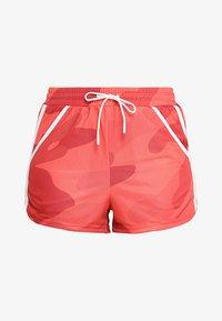 Craft - DISTRICT HIGH WAIST SHORTS - kurze Sporthose - red/orange - 4