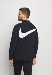 Nike Performance - Training jacket - black/black/white/clear - 2