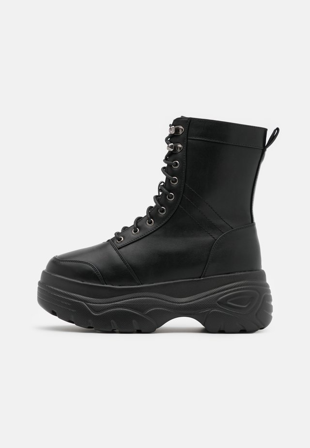 VEGAN - Platform ankle boots - black