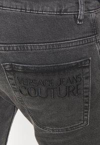 Versace Jeans Couture - MEDIUM WASH - Straight leg jeans - black - 7
