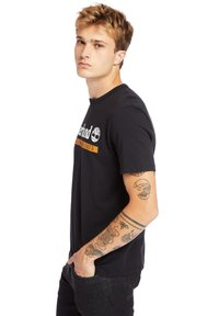 Timberland - Print T-shirt - black-wheat boot - 3